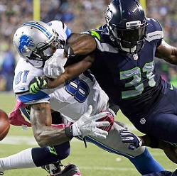 kam-chancellor-calvin-johnson-fumble-gi